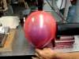 Popping A Balloon Inside Of A Balloon With A Laser