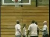 Girl Jumps Through Basket Ball Hoop