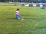 Isabelle Kicking Soccer Ball