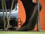 Shoeplay : Black Hosed Feet Under Table