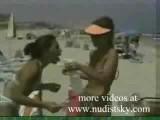 Nudist Playing On The Beach